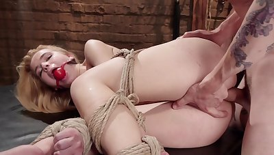 Young Alina West likes it rough and is hogtied and pain in the neck banged by a Specialist