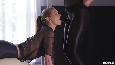 Two lesbians in spandex coupled with a strap-on dildo